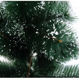 Красиво изкуствено коледно дръвче декорирано със сняг, с поставка