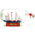 Сувенирен кораб-макет в стъклена бутилка на декоративна дървена поставка