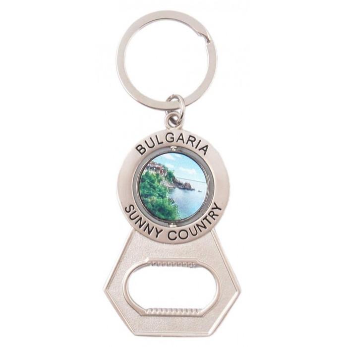 Сувенирен метален ключодържател - отварачка с въртяща се плочка - морски пейзаж и мъж и жена в народни носии, България