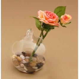 Декоративно цвете в поставка - стъклена колба с камъчета