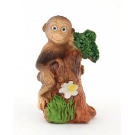 Сувенирна фигурка - маймунка върху дърво с цвете