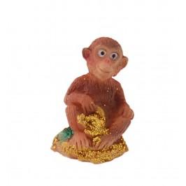 Сувенирна фигурка - маймунка върху жълтици