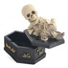 Сувенирен пепелник - скелет върху ковчег