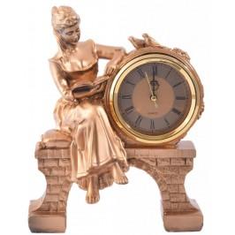 Декоративна фигурка с часовник - жена седнала на мост с книга в ръка