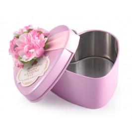 Метална кутия във формата на сърце, декорирана с цвете и нежна панделка
