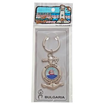 Сувенирен метален ключодържател - котва с въртяща се плочка, декорирана с два делфина с фар и кораб в море