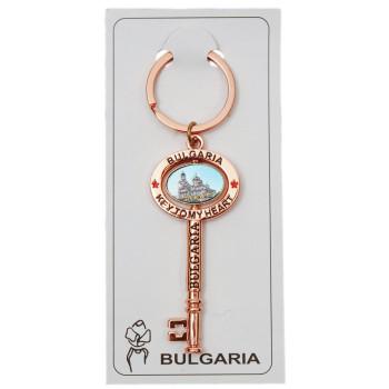 Сувенирен метален ключодържтел - ретро ключ с въртяща се плочка, декорирана с Варненската катедрала и двореца в Балчик