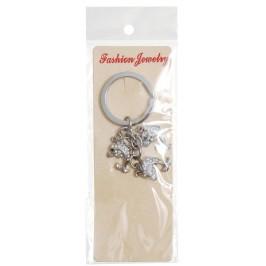 Сувенирен метален ключодържател - три делфина, декорирани с бели камъни