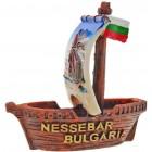 Декоративна фигура - кораб с платно, изобразено на него вятърната мелница в Несебър