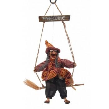 Сувенирна кукла - Баба Яга яхнала метла, която свети, издава звуци и движи крака